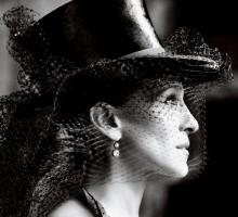 Sarah Jessica Parker gets dramatic in a Dior top hat.