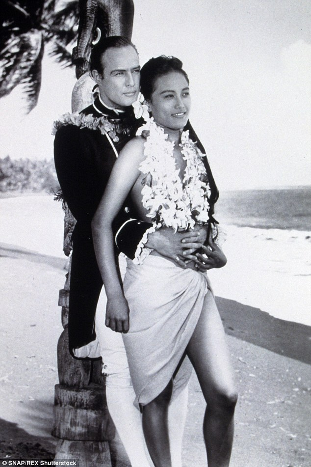 Marlon with third wife Territa Teriipaia, who he met while filming Mutiny on the Bounty, who was 18 years his junior